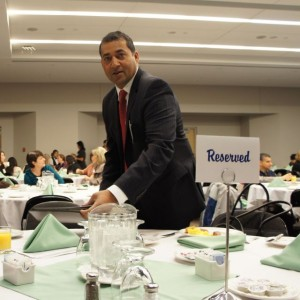 Raj Sherman takes his seat. One of the acknowledged guests.